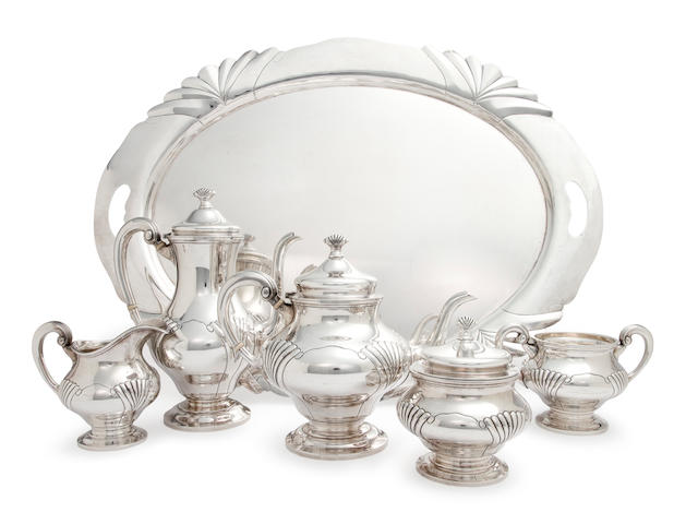 An American sterling silver five-piece tea and coffee service with matching oval two-handled tray and water pitcher<BR />by Tuttle Silversmiths, Boston, circa 1945-53
