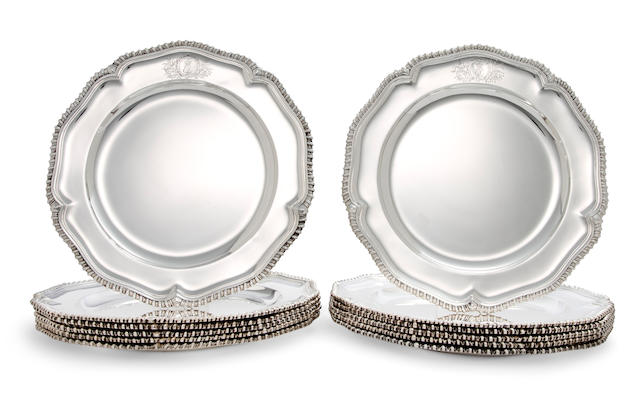 A set of eleven Irish George II sterling silver dinner plates and a similar Italian 800 standard silver meat plate<BR />the first by William Williamson, Dublin, 1737