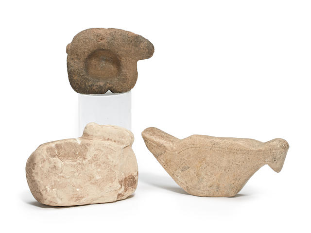 Three animal effigy stone artifacts