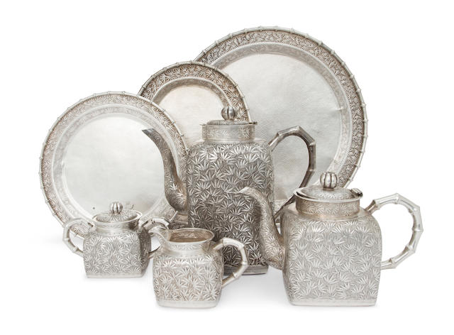 A Chinese Export silver four-piece tea and coffee service with three matching trays<BR />by Kan Mao Hsing, Liukiang, circa 1890