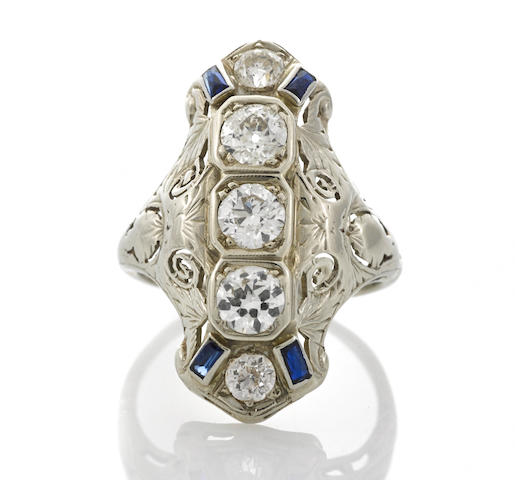 A diamond and synthetic sapphire ring,