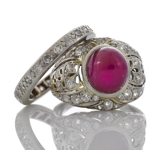A ruby and diamond ring together with a diamond eternity band