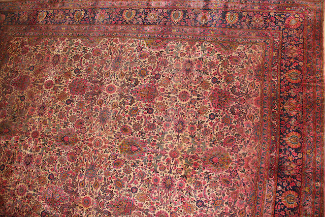 A Lavar Kerman carpet size approximately 12ft. 5in. x 15ft.