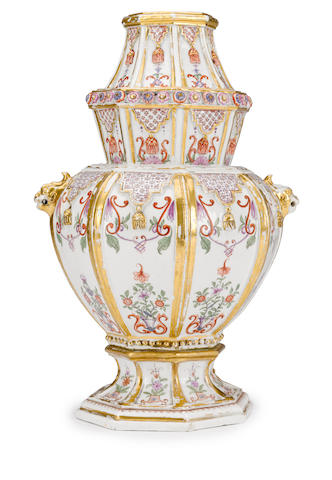 A rare Du Pacquier chinoiserie parcel gilt and polychrome enamel foliate and arabesque decorated octagonal porcelain vase<BR />circa 1740