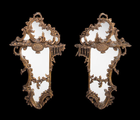 A pair of Venetian Baroque and later giltwood and gilt composition mirrors<BR />one mid-18th century, the other late 19th/early 20th century