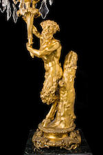 "A pair of French Neoclassical style gilt bronze and cut glass ten-light candelabra ""à faune et faunesse""<BR />after a model by Clodion (Claude Michel, 1738-1814)<BR />fourth quarter 19th century"