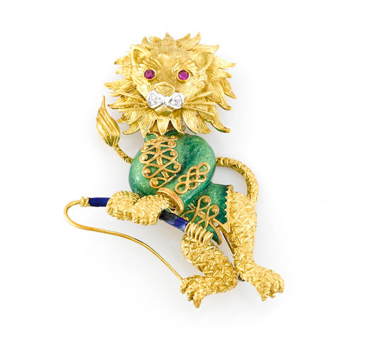 An enamel, ruby and diamond lion brooch