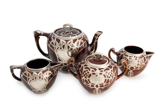 An American sterling silver overlay glazed ceramic assembled four-piece tea set<BR />late 19th century