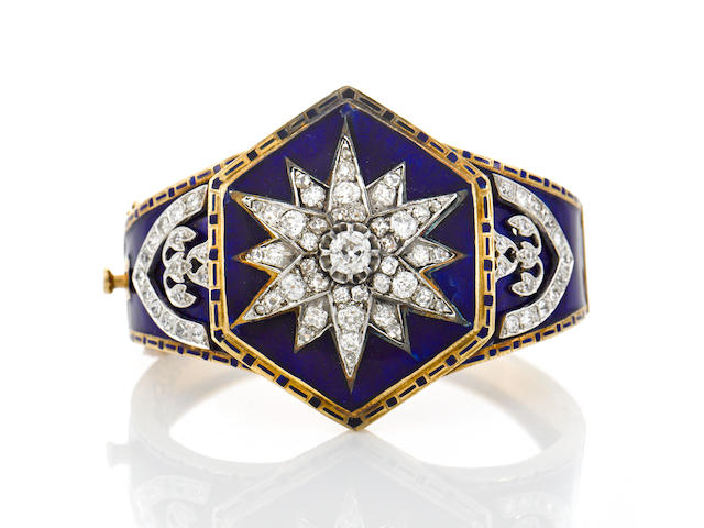 A diamond and enamel star motif bangle bracelet,