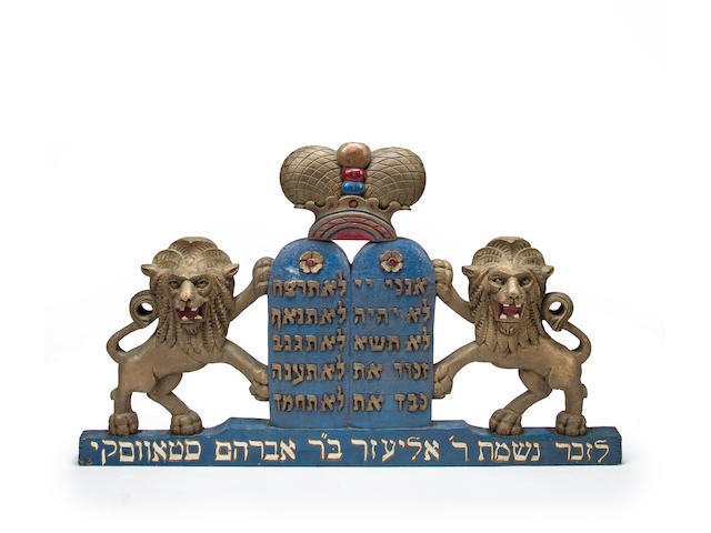 A paint-decorated, gilt-heightened wood carving of lions flanking Decalogue artist unidentified New York City (lower east side), c.1920