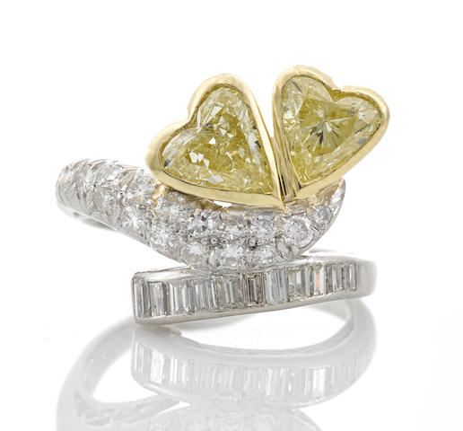 A fancy light yellow diamond and diamond ring