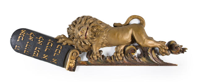 A paint-decorated, gilt-heightened wood carving of lions flanking a Decalogue, surmounted by a Torah crown  artist unidentified New York City (lower east side); c.1920