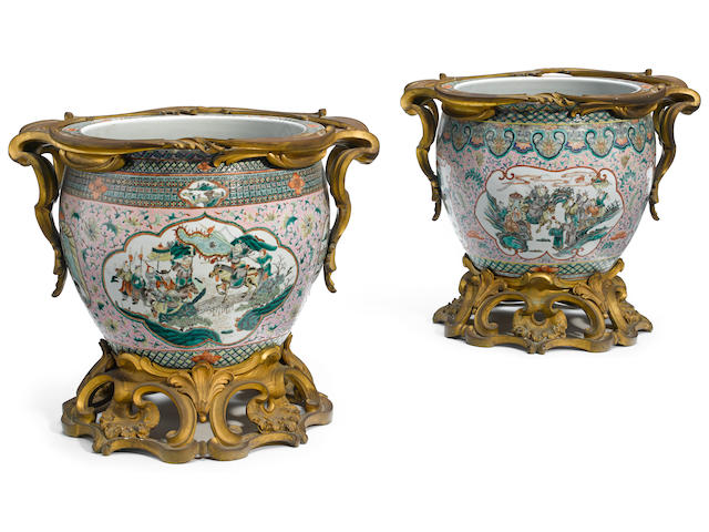An impressive matched pair of French gilt bronze mounted and Chinese porcelain fish tanks late 19th century