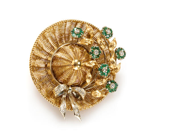 An emerald, diamond and 18k bicolor gold hat brooch