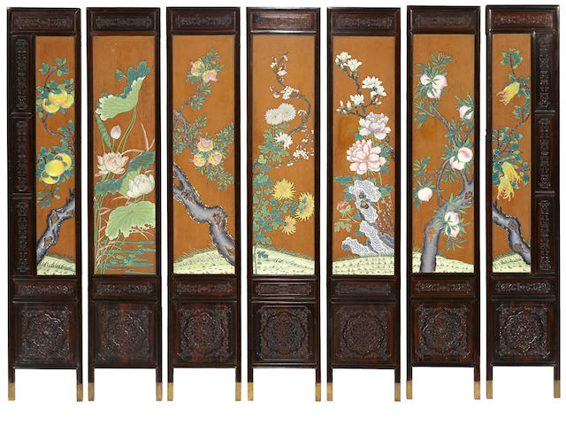 A lacquered wood seven-panel floor screen with applied cloisonné enamel decoration Republic period