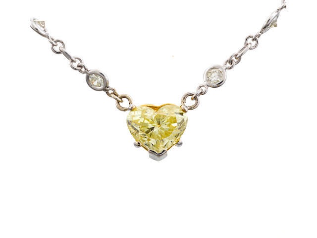 A fancy yellow diamond and diamond necklace