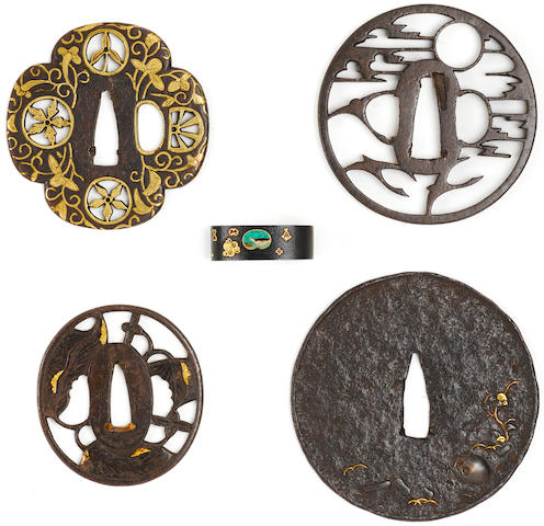 Eight Tsuba and a Hirata-school fuchi Edo period (18th century) and later