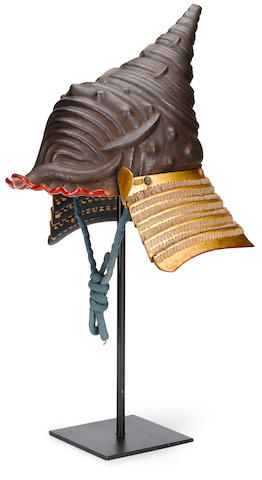 An impressive iron kawari kabuto (eccentrically shaped helmet) in the shape of a conch shell Edo period (18th century)