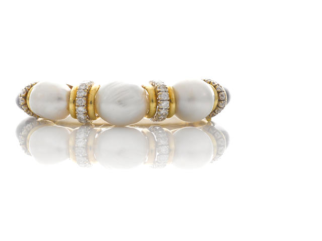 A cultured pearl, black onyx and diamond bangle bracelet