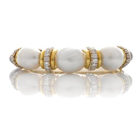 A cultured pearl, black onyx and diamond bangle bracelet