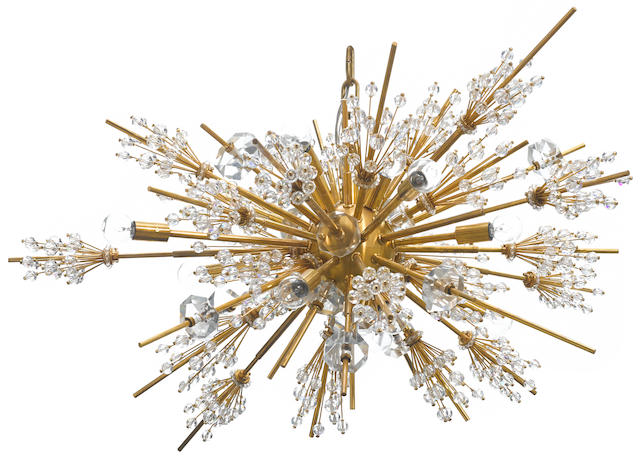A Lobmeyr gilt brass and faceted glass fifteen light Metropolitan chandelier Designed by Hans Harald Rath for the Metropolitan opera house circa 1963