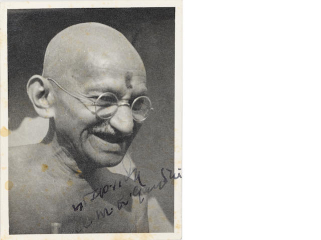 "GANDHI, MOHANDAS K. 1869-1948. Photograph Signed (""M.K. Gandhi"") and Inscribed,"