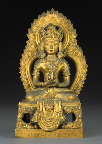 A gilt bronze figure of Amitayus Qianlong, dated by inscription to 1770