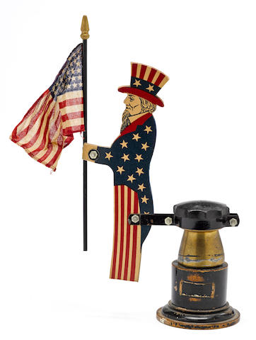 An 'Uncle Sam' radiator accessory with flag,