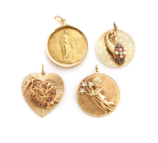 A group of four gem-set and gold charms