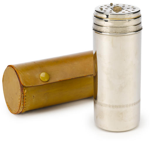 A small cylinder German cocktail shaker,