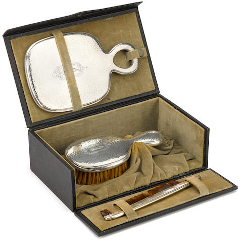 A gentleman's Sterling vanity set,