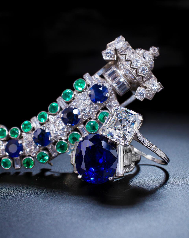 An Art deco diamond, emerald and sapphire brooch, Charlton,