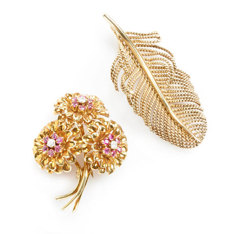 A diamond, ruby and 18k gold floral bouquet brooch together with a 14k gold leaf brooch,