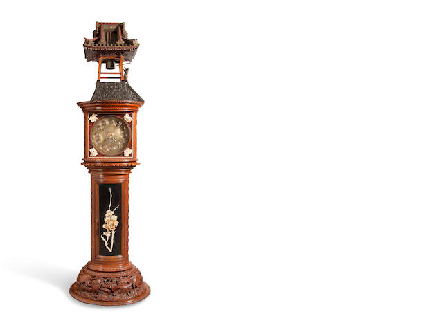 A Remarkable elaborately carved and inlaid automaton striking hall clock Commissioned from Tiffany & Co., New York, the case Japanese, fitted with Tiffany movement No. 759, delivered in April 1901