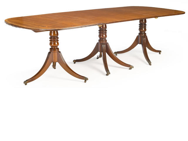 A Regency rosewood, hollywood and satinwood inlaid mahogany triple pedestal dining table first quarter 19th century