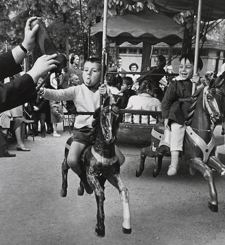 Alfred Eisenstaedt (1898-1995); Boy hooking the ring, Paris;