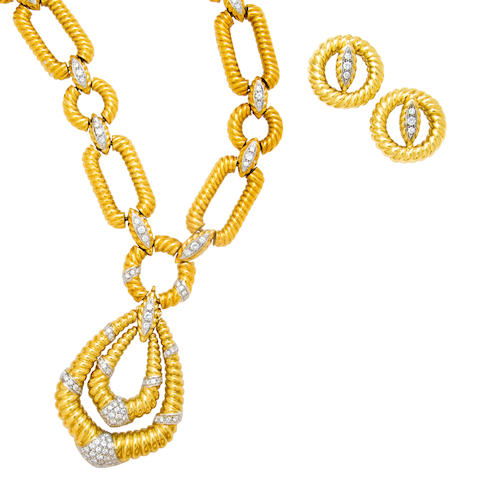An eighteen karat gold and diamond pendant necklace and earclips,
