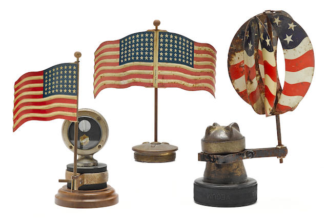 A lot of three Americana tin painted flag mascots and radiator embelishments,