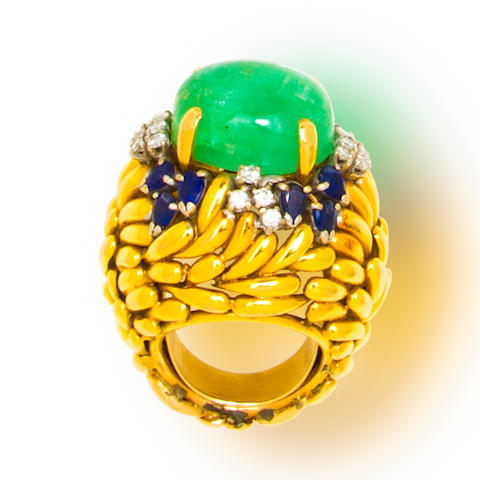 An emerald, sapphire, diamond and fourteen karat gold ring