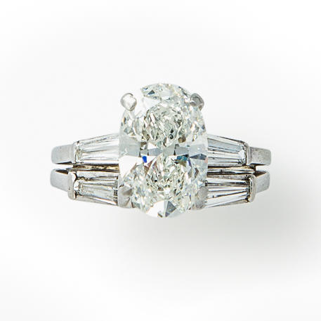 A diamond solitaire ring and band