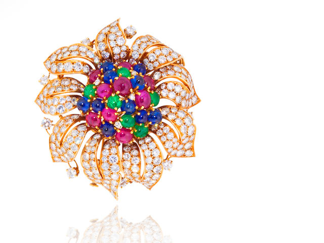A diamond and gem-set flower brooch,