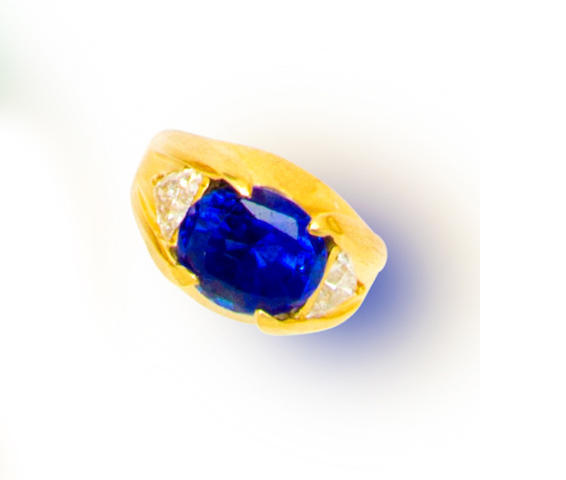 A sapphire, diamond and eighteen karat gold ring