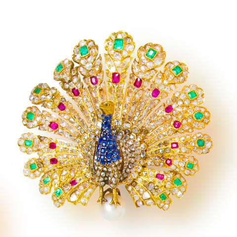 A gem-set and diamond peacock brooch, Gustave Baugrand,