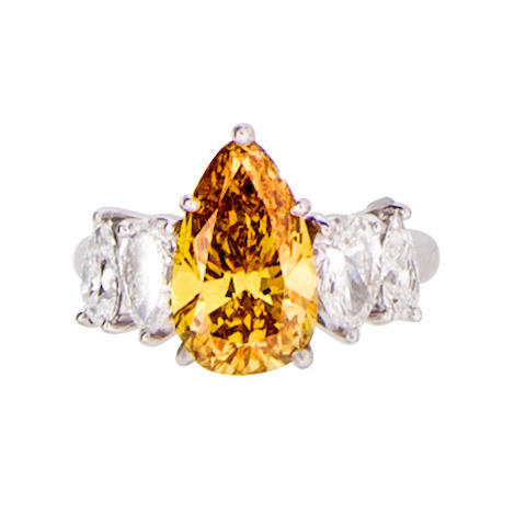 A colored diamond and diamond solitaire ring