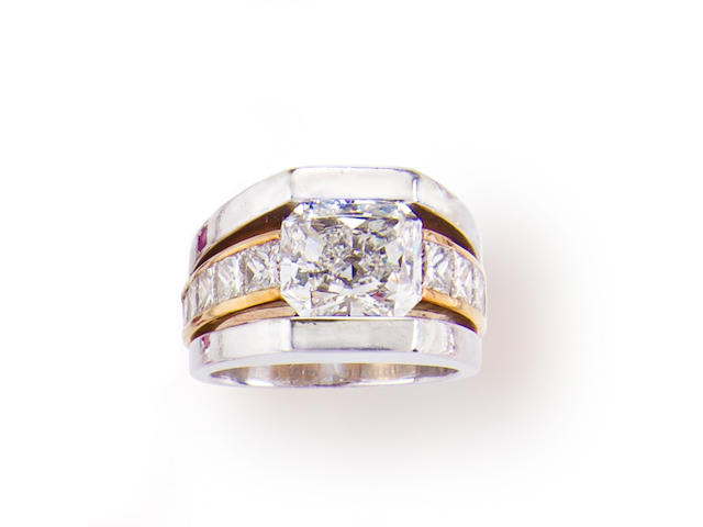 A diamond, platinum and eighteen karat gold ring