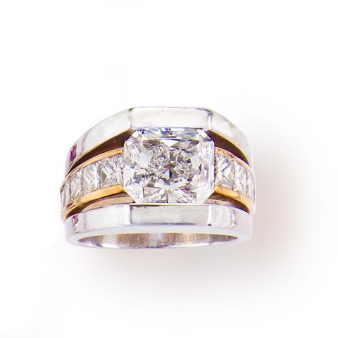 A diamond, platinum and eighteen karat gold ring