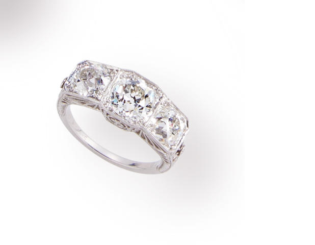 An art deco platinum and diamond three stone ring,