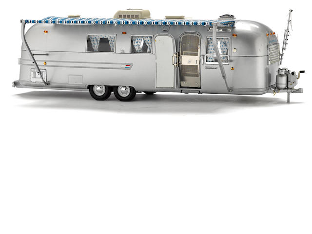 A 1/24 scale model of a airstream trailer by Franklin mint,