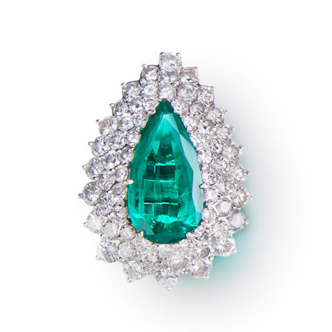 A synthetic emerald and diamond ring
