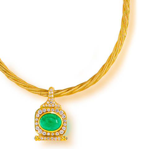 An emerald, diamond and eighteen karat gold pendant necklace